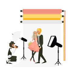 photographer shooting a wedding couple in studio vector image vector image