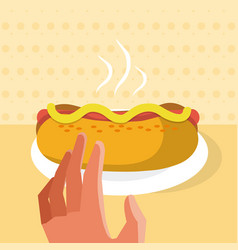 Hand grabbing a hotdog vector