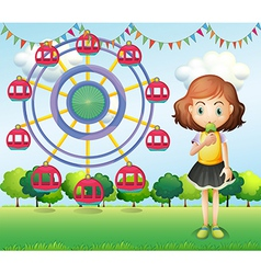 A girl eating an ice cream near the ferris wheel vector image