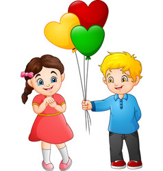 cute little boy giving a balloon to the girl vector image