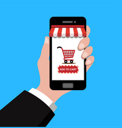 hand holding smartphone with shopping cart vector image