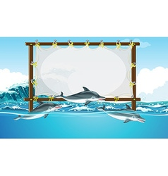 Border design with three dolphins swimming vector