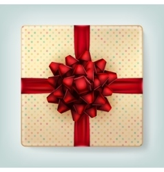 Red bow on polka dot gift box top view EPS10 vector image