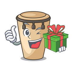 With gift conga mascot cartoon style vector