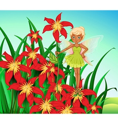 A fairy standing above a red flower vector image