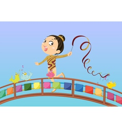 A girl holding a stick with ribbon vector image