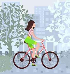 Beautiful girl is riding on a bicycle in a city vector image vector image