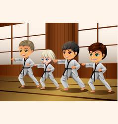 Kids practicing martial arts in the dojo vector
