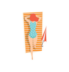 young woman in blue swimsuit lying on her stomach vector image