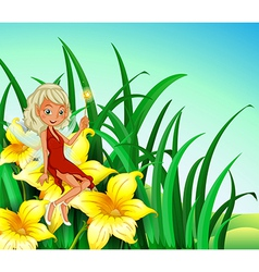 A fairy holding a wand sitting above a flower vector image