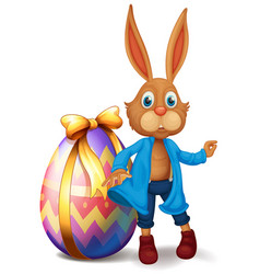 brown bunny and easter egg vector image vector image