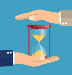 business hand holding a hourglass vector image