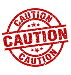 Caution round red grunge stamp vector