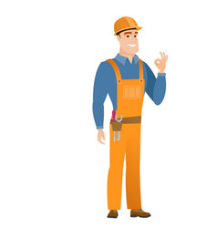 smiling builder showing ok sign vector image