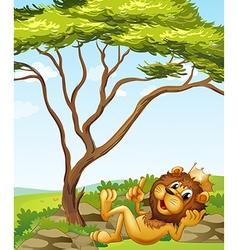 A king lion lying down near tree vector