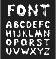 Grunge white alphabet on a black background vector image