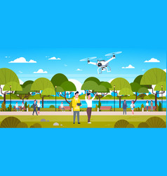 couple flying drone in park man and woman using vector image