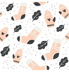 seamless pattern with cute socks mittens leaves vector image