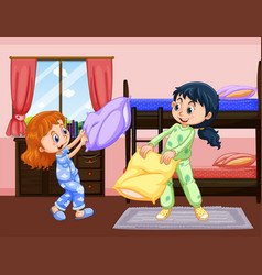 Two girls playing pillow fight in bedroom vector