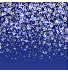 Snowflakes falling on blue background vector