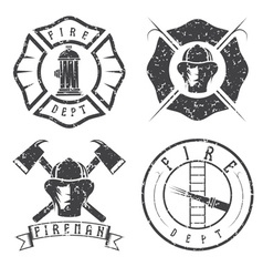 Grunge set fire department emblems and badges vector