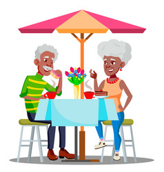 Happy elderly couple in cafe at a table drinking vector