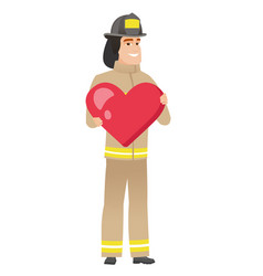 caucasian firefighter holding a big red heart vector image