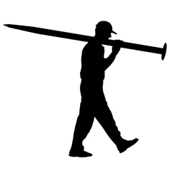 Silhouette porter carrying the large nail in his vector