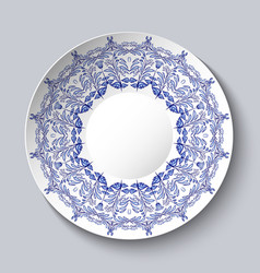 Souvenir porcelain plate with a blue floral vector