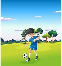 A boy playing soccer at the forest vector image vector image