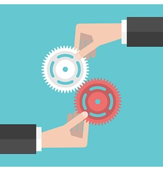Two hands holding gears vector