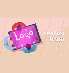 Creative designers team working sit at desk vector