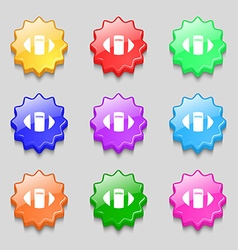 rugby ball icon sign symbol on nine wavy colourful vector image