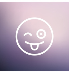 Happy winking emoticon with protruding tongue thin vector image