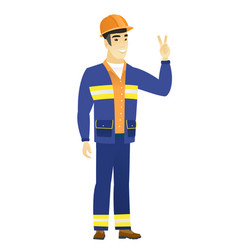 asian builder showing the victory gesture vector image vector image