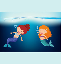 two mermaids swimming under the sea vector image