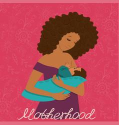 A young mother breastfeeding her baa postcard vector