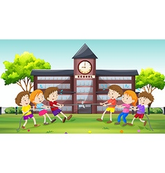 Children playing tug of war at school vector