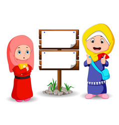 Muslim kids cartoon with wooden sign vector