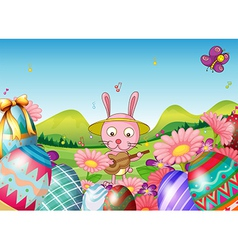 A bunny with a guitar and the easter eggs in the vector image vector image