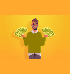 Excited man holding money bills financial success vector