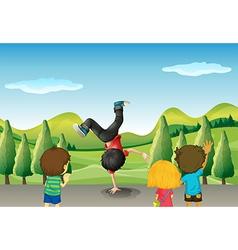 Kids watching a boy dancing vector