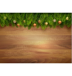 Christmas tree branches with baubles on a wooden vector image vector image