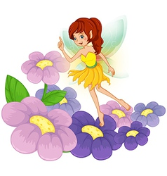 A fairy at the garden with fresh flowers vector image vector image