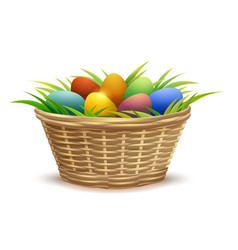 wicker basket full of easter eggs on grass vector image vector image