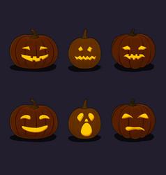 set of pumpkins on black background vector image