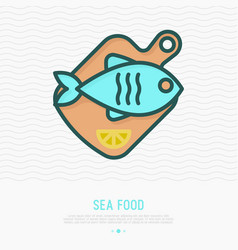 fish on wooden cutting board with lemon vector image