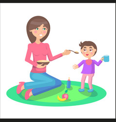 mother feeds baby boy who stands and holds cup vector image