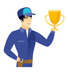 Young asian mechanic holding a trophy vector