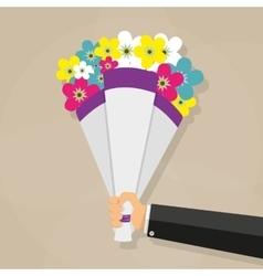 Businessman hand holding bouquet vector image vector image